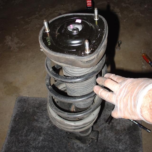 Spring: Rear strut assembly removed.