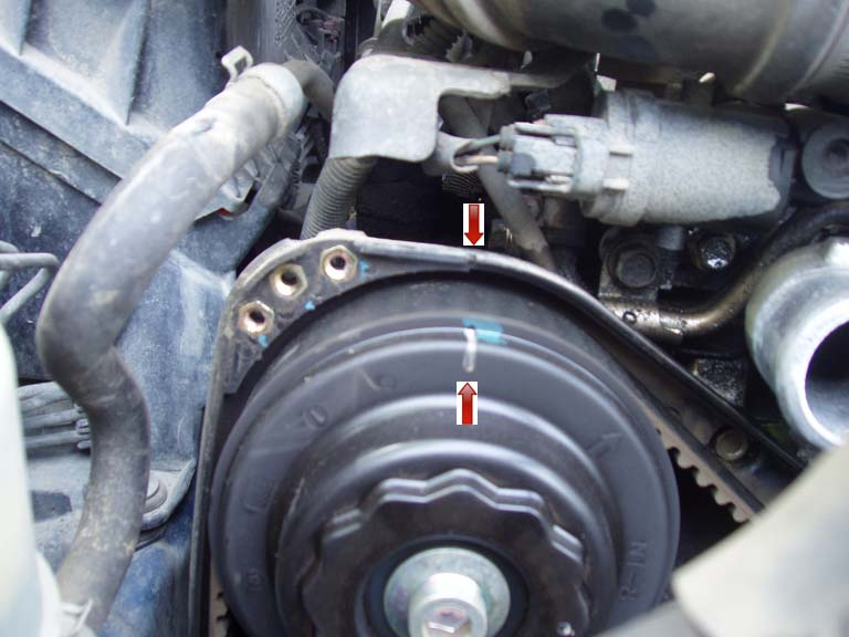Timing Belt: Upper Left: Notice that the lines on the old belt are all rubbed off.