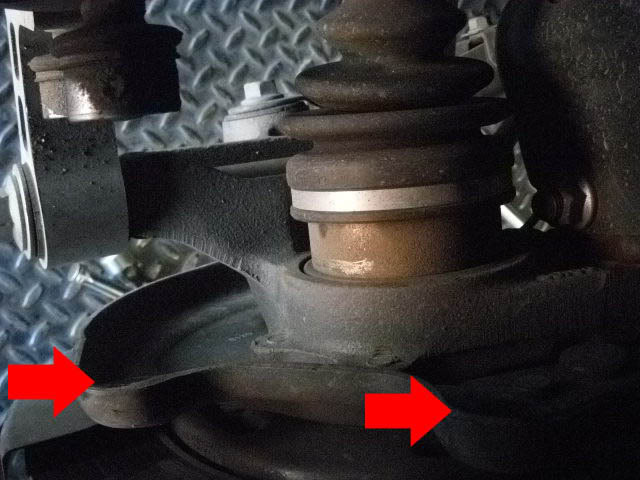 - Now, located behind everything are two bolts holding your caliper on. Remove two bolts and set bracket aside. (Make sure your caliper is in a safe place, not dangling around)
