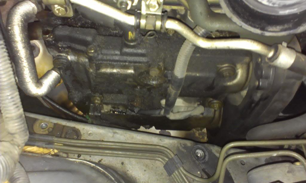 Valve cover gasket: In the center are the two coil packs that need to be removed.