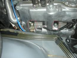 Sti spark plug location