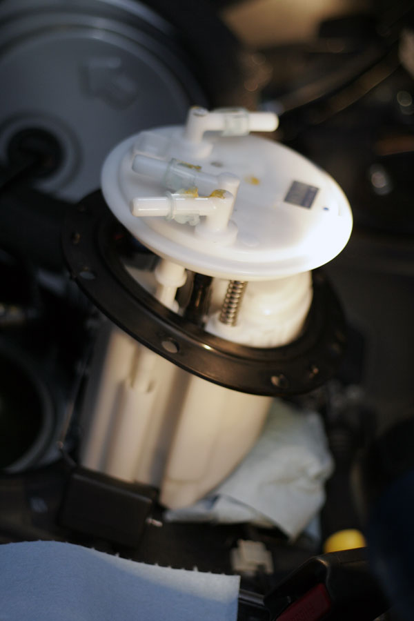 Fuel Pump: Gently remove the metal bracket surrounding the entire assembly to gain access to the housing and place it somewhere safe. Slowly remove the fuel pump assembly by contorting it, be careful not to damage the float or sensor.