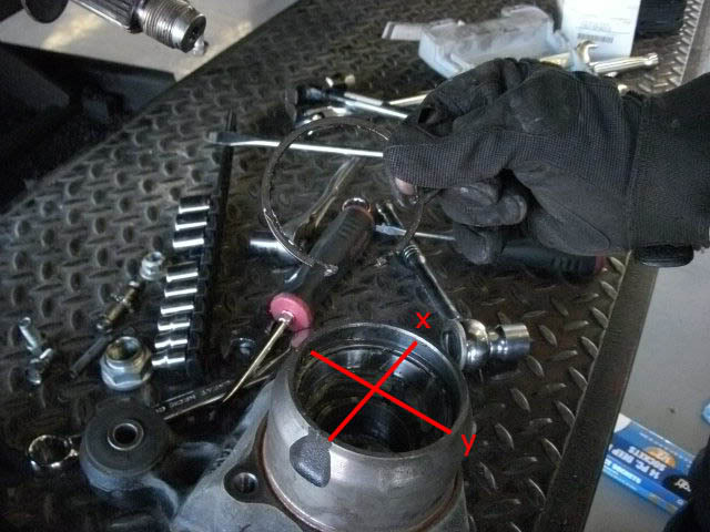 Rear wheel bearing: Take a look fron the front side and you will see a snap ring. You will need to remove that. I used a medium sized flat tip screwdriver to compress and pry it out