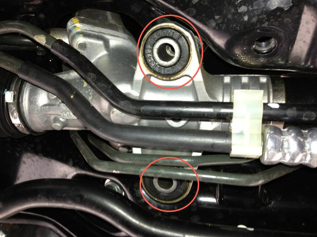 Steering Rack Bushings Install on a 08+ STi: Exact the bushings that are circled in red with the whiteline supplied tool.