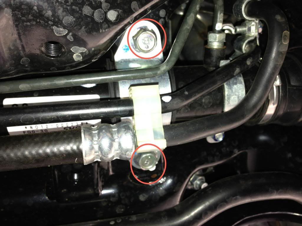 Steering Rack Bushings Install on a 08+ STi: You might have to use the flathead screwdriver to pry the metal bracket away from the bushing initially.