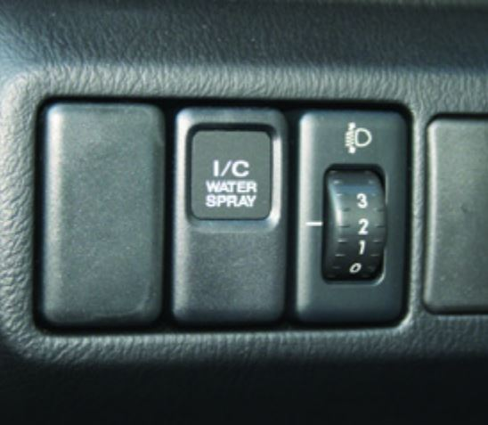 Subaru Turbocharger: The intercooler water spray system activation button, found on 2004 and later STi models, is located on the left side of the steering wheel.