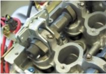 Valve Adjustment Tool and Adjustment Procedures: As we mentioned, it takes a special tool to work within the limited clearance area between the cylinder heads and the frame rails.
