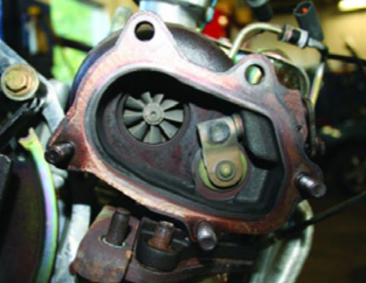 Subaru Turbocharger: The wastegate valve is located in the turbo exhaust side housing.